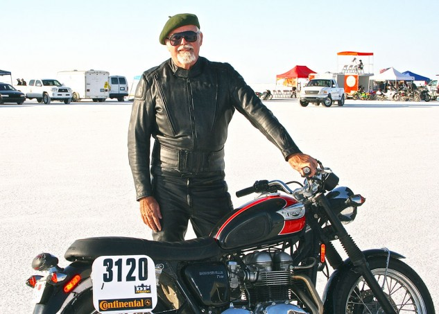 The author at the salt flats in 2010 with a Triumph Bonneville, which did not blow up.