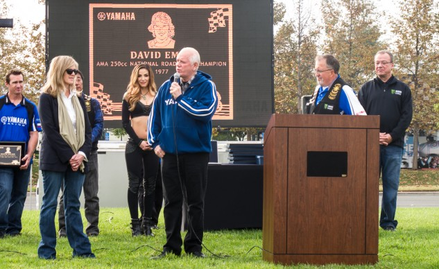 Daytona winner, Don Emde, and his sister, Nancy Emde-Steward, accept the plaque honoring the  1977 AMA 250cc Championship won by their brother, David Emde, who died in 2003.