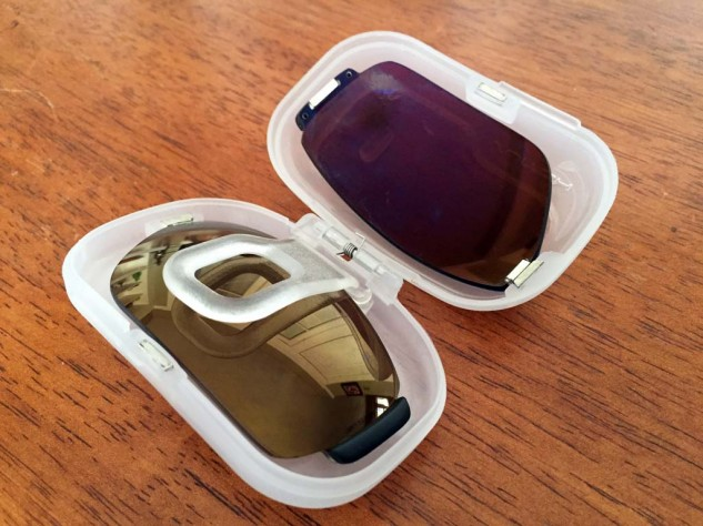 """Each pair of Switch lenses come in their own """"pod."""" If I'm wearing the True Color Grey lenses, I'll bring one or two of these pods with lenses for low-light and/or nighttime riding. They're small enough to fit into most pockets, and it beats carrying the much larger, $25 optional sunglass semi-hard case."""