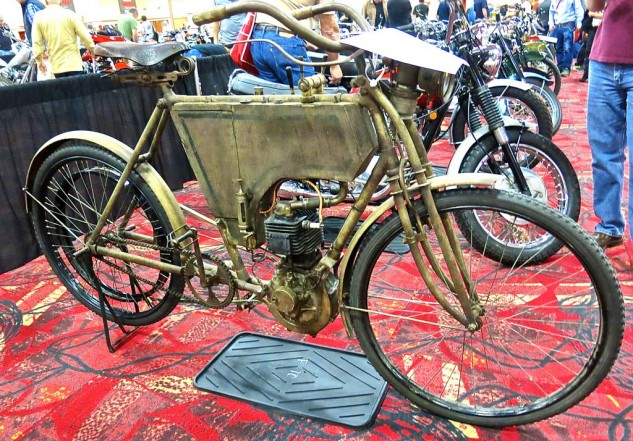 "Few in attendance had ever heard of, let alone seen, a 1903 REX Belt Drive. But Englishman Steve Norton knew what it was, and that he wanted it, and won the bid at $66,000. Not only that, he plans to ride the 2.25-horsepower 344cc Single in this year's Cannonball Rally. And having served as crew chief for Texans Mike and Buck Carson for two years, Norton is aware of the challenge. ""It's a really solid engine,"" he said. ""It will take it."" He says the engine will tell him what speed it wants to run. ""We'll find the sweet spot, maybe 25 to 30 mph."" He figures they have two chances. ""Either it'll go or it won't."" British resolve."