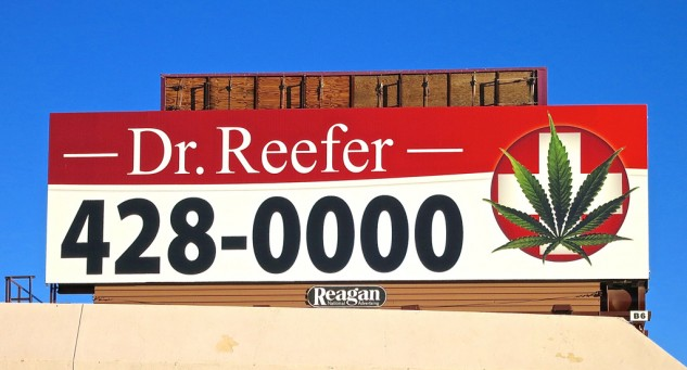 Speaking of doobies: One can imagine the poor luckless gambler, awakening with a hangover and a bad case of post-table stress syndrome, who opens the hotel window curtain and sees this billboard across the street. Medication is just a phone call away.