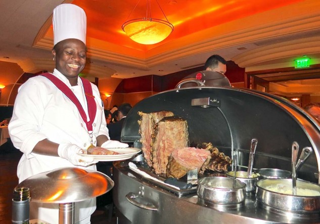 """Gourmet Interlude: Just about every other joint in Vegas """"specializes"""" in prime rib, but for the real deal, you go to Lawry's. Carnivores looking to celebrate their luck at the casino can expect first-rate service and their cut of choice carved at the table. And the seafood is good. The art deco motif is deluxe, the wine list impressive, and please, """"Gentlemen are asked to remove their hats before entering the dining room."""""""
