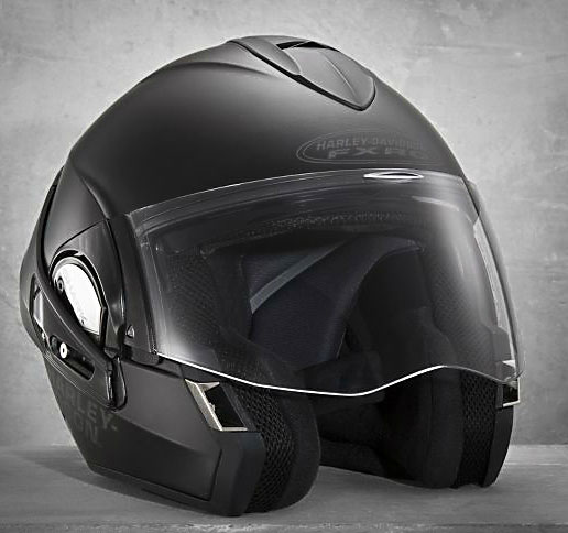 H-D's FXRG Dual-Homologation helmet ($495) is a full-face lid that converts to an open-face in simple fashion. To change from full-face to open-face, depress the unlock button and swing the chin bar over the top of the helmet to its aerodynamic resting place at the rear of the helmet. Voila, open-face helmet! The FXRG Modular helmet employs a swinging chin bar but in a more traditional modular fashion where the chin bar does not revolve to the rear of the helmet. Both helmets feature an internal sun visor.