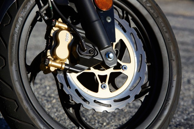 The front brake's not quite as strong as it looks, but more aggressive pads might fix it right up? The SYM does ride on modern radial rubber.