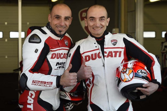 Alessandro Valia (left) says he circulated Mugello on a stock 1299 with race-compound tires at a time of 1:55.3, which is less than 8 seconds slower than the lap record set on a million-dollar MotoGP bike by world champ Marc Marquez. On the right is Claudio Domenicali, Ducati's CEO. It's a fair bet to say he rides faster than any CEO of a major corporation.