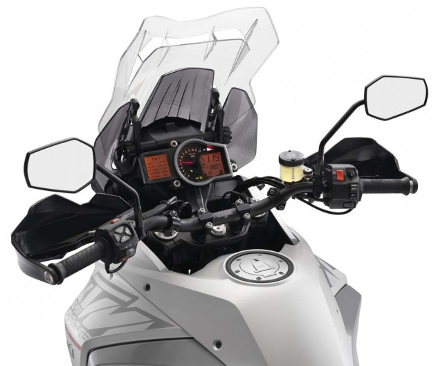 The larger windscreen displaces more wind than the 1190 Adventure, creating a pleasant bubble of calm for the rider. Turbulence is tempered by way of the reinforced slot near the top of the windscreen. It works, but the design is unavoidably, directly in a rider's line of sight which is a nuisance until you get use to its presence. Unlike the 1190 Adventure, the 1290's screen can be adjusted on the fly. Note the cruise control switchgear on the right handlebar.