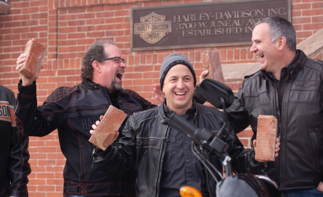 Bill Davidson, great-grandson of company co-founder William A. Davidson, Christian Walters, Managing Director, United States at Harley-Davidson Motor Company, and Matt Levatich, President and Chief Operating Officer of Harley-Davidson Motor Company celebrate after removing a brick from the historic Milwaukee headquarters.