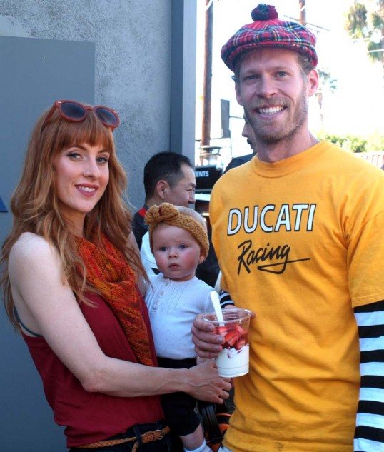 """Organizer of the event and mover and shaker behind all the buzz and posters and event perks, is Deus crewmember Nevin, seen here with his wife Scarlet and baby girl Clementine. Asked about the tartan headwear, which seems a bit Scottish, Nevin laughs and says, """"It's the only thing with some red in it that I could find."""""""
