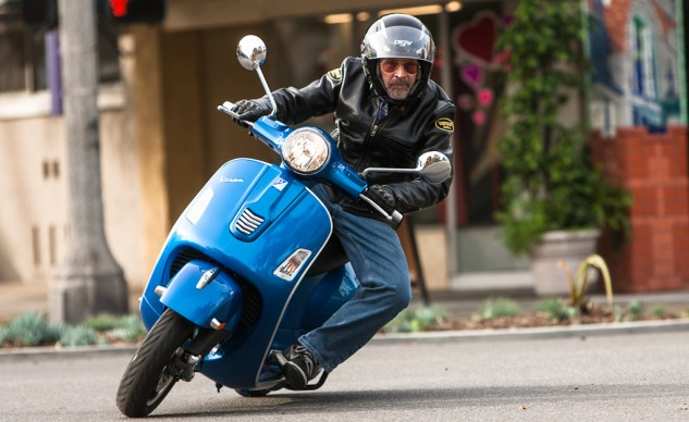 Why grow up now? Or groom? Twelve-inch wheels and a wheelbase 5 or 6 inches shorter than the other scoots here make the Vespa the MetroGP champion.