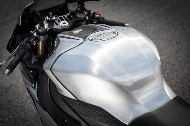 Both R1 models get aluminum tanks, but the R1M is hand finished, meaning no two tanks are exactly alike.