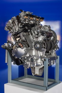 The all-new R1 engine is only slightly wider than a piece of paper held lengthwise. Meanwhile, it's lighter and more powerful than the model it replaces. Look closely and you can see the transmission gears hollowed out for more weight savings.