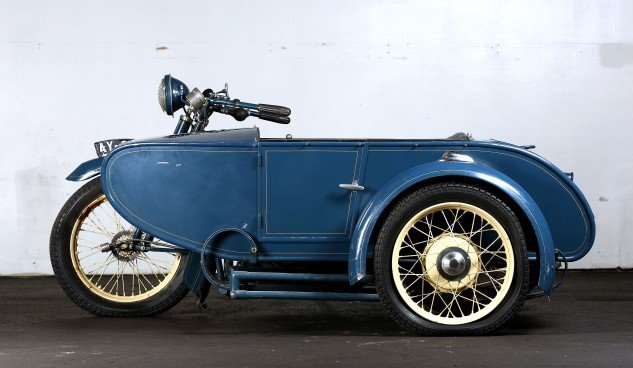 The Watsonian sidecar, in production from 1910-1956, presents  a sleek profile.