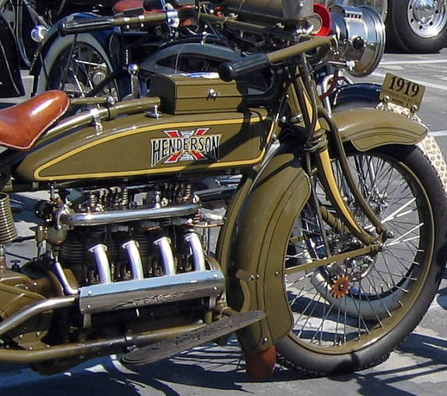 "1919 Henderson was available in military inspired olive green. The 1147cc (70 cu. in.) four-cylinder pumped out 14.2 hp. The new Z-2 ""electric"" models for the year include a GE generator. The gas tank also showed the first use of the new Henderson with red Excelsior X logo."
