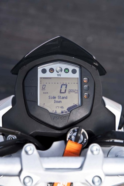 Comprehensive instrumentation includes easy-to-read digital speedo and a gear-position indicator, fuel economy info, a fuel gauge, temperature levels, and a programmable shift light. The tiny numerals on the tiny bar-graph tach frustrate.