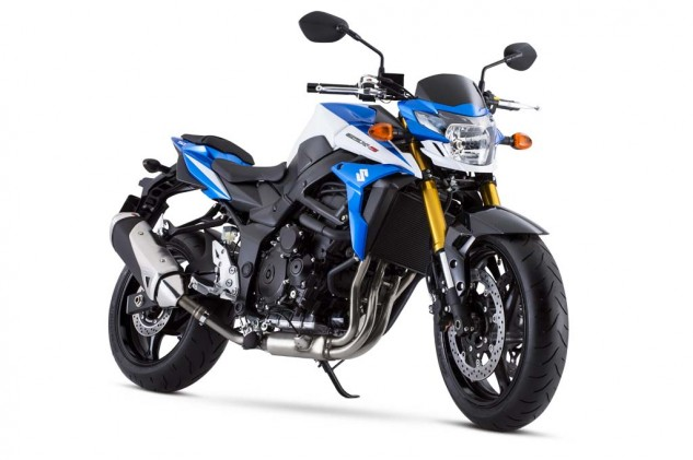 The standard model is available in only Metallic Matte Black, whereas the GSX-S750Z is offered in Metallic Triton Blue/Pearl Glacier White for $150 more ($8149). Additional features of the Z model include bright-gold anodized fork legs, silver matte-finish handlebars, a drive chain with blue side plates, and a red rear shock absorber spring.