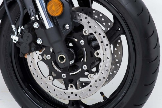 Twin 310mm discs are gripped by dual piston Tokico calipers up front, with a single 240mm disc and single-piston caliper at the rear. Stopping power and modulation seems more than adequate for street/sport application.