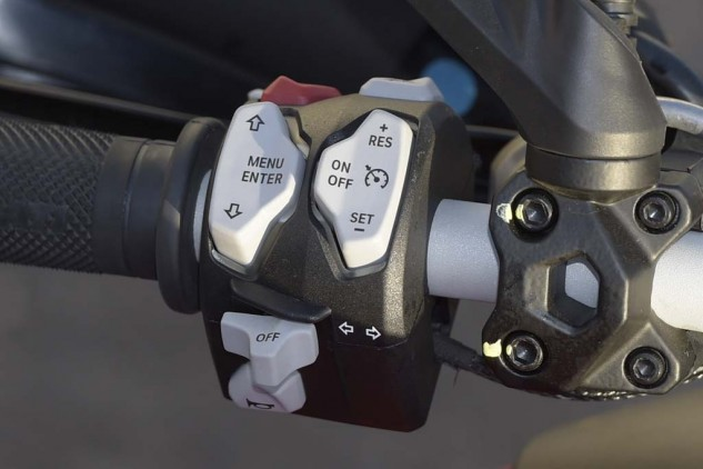 The cruise control couldn't be simpler or easier to use. The rest of it could be... There's a 12V socket up front in the cockpit, and another one under the seat, along with a USB port.