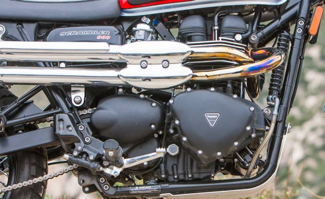 The Triumph's high-pipes do more than just look cool when navigating around and over off-road obstacles. The Trumpet also wears a bash plate below its frame rails, and carries 0.6 gallons more fuel: 4.2 gal/Triumph vs 3.6 gal/Ducati.