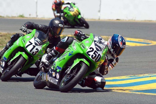 Todd Grice (250) and Bobbie Wetterau showing expert form as they battle for 7th place, Sonoma Raceway, 2011. Wetterau's best lap time was just 0.6 second ahead of Grice's. Photo by Gary Rather.