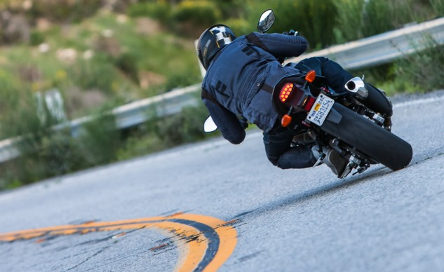 The Gixxus handles well enough to invite peg scraping, and has enough cornering clearance to keep things exciting.