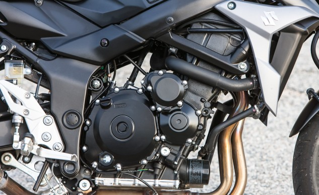 The re-tuned GSX-R750 mill features revised cam profiles and timing, as well as reshaped intake and exhaust tracts to give the naked bike more low- and mid-range power. In true Suzuki fashion, the transmission shifts smooth as butta.