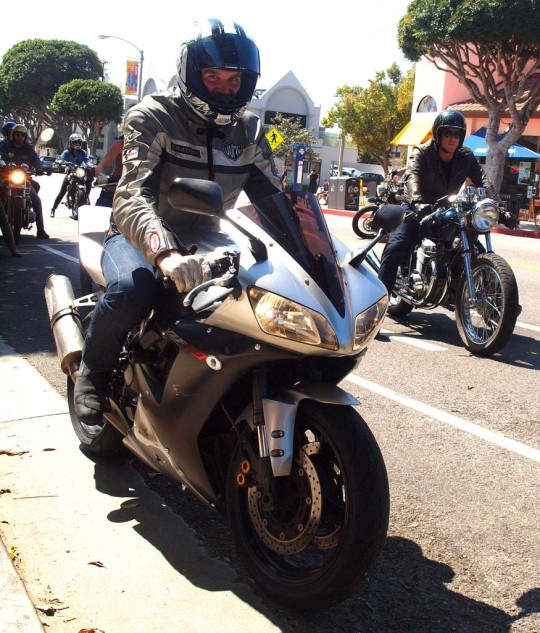 """A Yamaha YZF-R1 getting along with a 1974 SS Classics custom-built CB750 ridden by """"Sex and the City"""" actor Jason Lewis."""