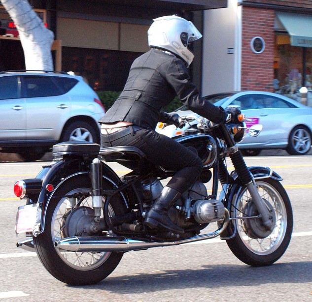 """Female rider on a 1960s R50/2 BMW. Several custom Beemers also """"starred"""" in the film."""