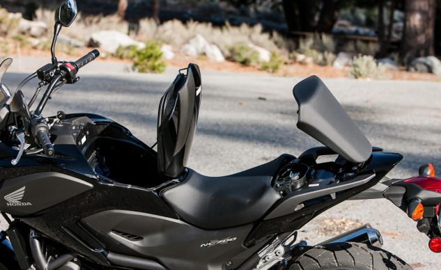 Brilliant. The locking boot will contain a helmet or a 12-pack; 3.7 gallons of gas goes under the seat (and makes the NC feel light and controllable), which is enough for 200-plus mile range given the NC's awesome 60-plus mpg.