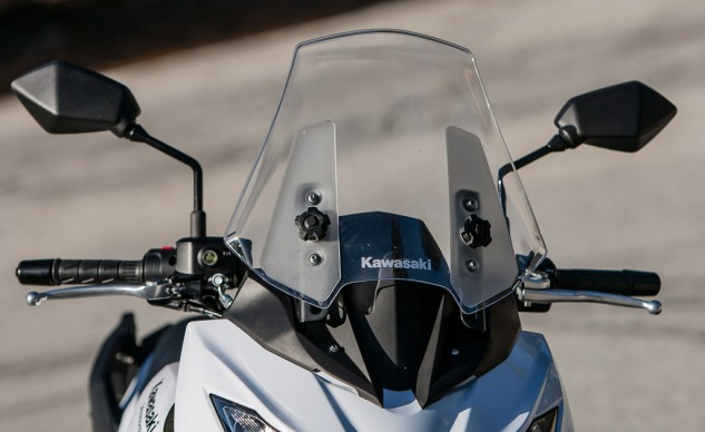 Nothing could be much simpler than loosening those two knobs to slide the Versys' windscreen up and down a few inches. Both hand levers are adjustable.