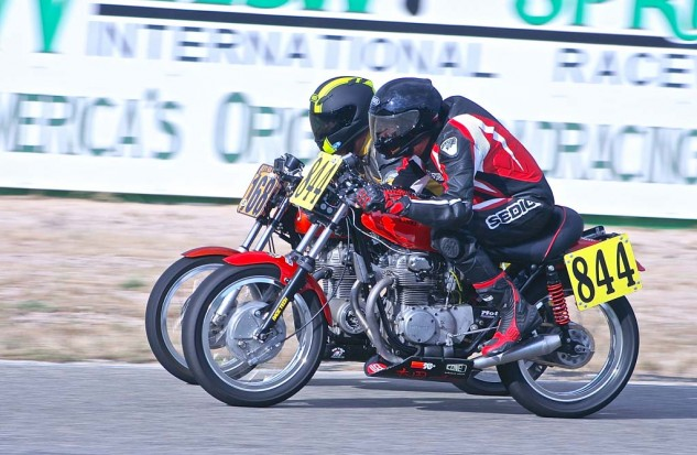 Evenly matched old Honda Twins provide much of the racing excitement.