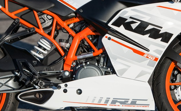 The distinctly orange KTM trellis frame houses, among other things, a preload adjustable WP shock. Note its close proximity to the exhaust hump in black directly in front. We theorize exhaust heat could be affecting the shock's damping abilities, as its lack of rebound damping saps confidence to push its limits. Kudos to KTM, though, for equipping the RC with Pirelli Diablo Rosso II tires, stock.