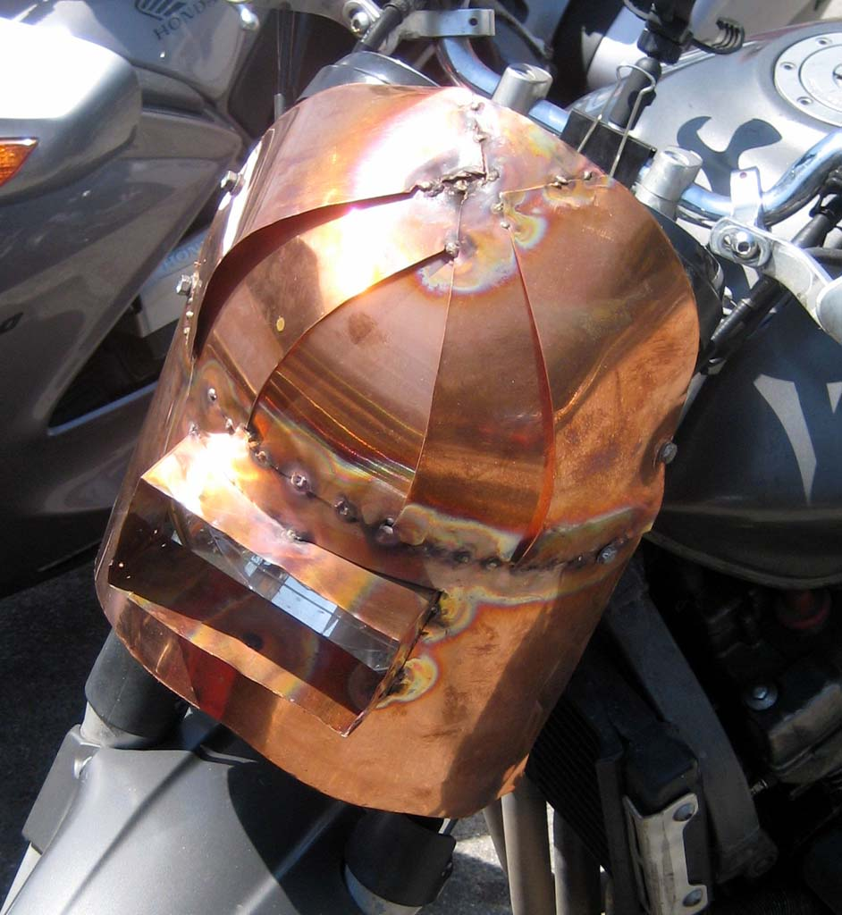 Call it Mad Welder meets Mad Max. Nice mix of copper and welding run amuck makes for a unique fairing.
