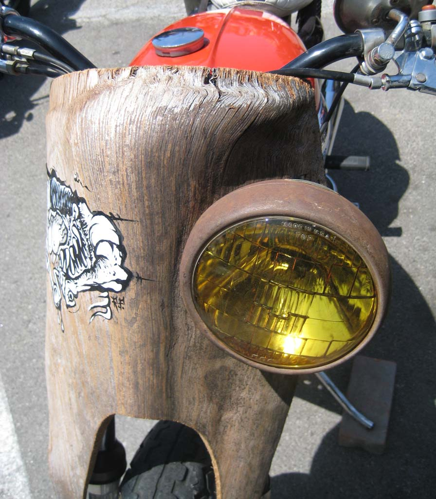 Recycling chunks of old palm trees give vintage Triumph's fairing a rustic, tiki-party look.