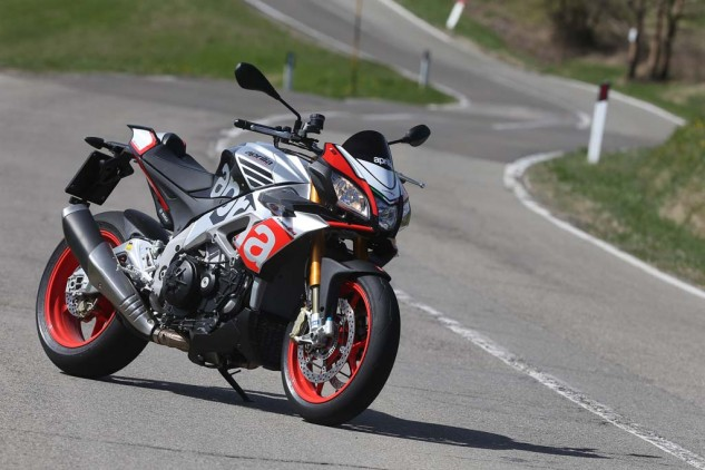 For the first time, Aprilia is offering a Factory version of the V-4 Tuono, seen here in its Superpole graphic. Retailing for a $2,200 premium over the $14,799 RR, it includes Ohlins suspension and steering damper, aluminum (rather than the RR's steel) front brake rotor flanges, a wider 200/55-17 rear tire and red wheels – wheels are not the lighter, forged-aluminum hoops sometimes fitted to Aprilia's Factory models. The $16,999 Factory is scheduled to arrive in American dealers this month, a couple of months ahead of the RR.