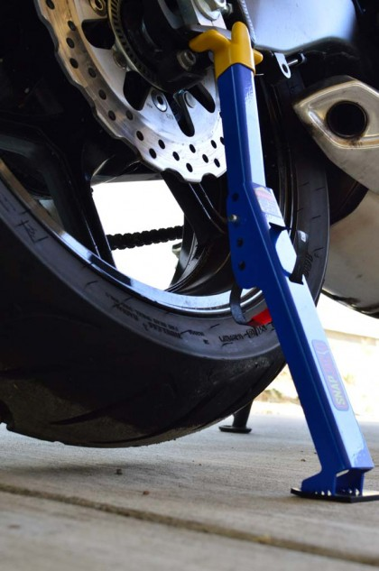 When fully extended, the rear tire should be just high enough from the ground to spin freely.
