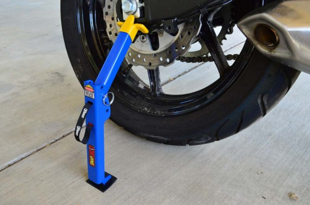 Place the base of the SnapJack approximately three or four inches from the rear tire, with the swingarm cradle positioned on a flat portion of the swingarm.