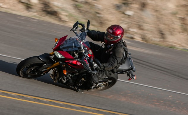 If sport-touring, with emphasis on sport, is your thing, the FJ is nothing if not a more comfortable, better suspended FZ-09 with a larger fuel tank and availability of optional hard-luggage. The FJ is lighter and can turn quicker than the Tiger on paved roads.