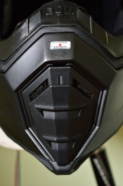 The chin vent is impossible to miss and is incredibly simple to operate. However, the foam filter behind it works a little too well and blocks air from reaching a rider.