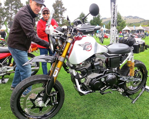 Jim Carducci points out a detail on his Sportster-based SC3 Adventure model.