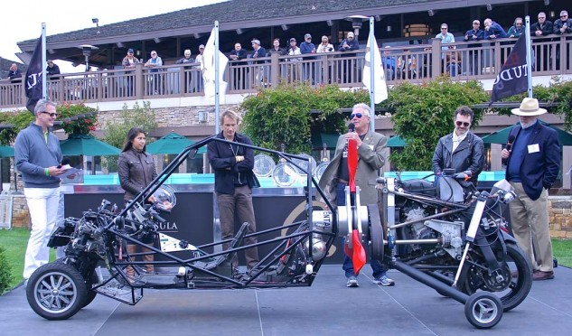 """Deszo Molnar accepts the Innovation award from Craig Vetter for his own creation, the Molnar G2. A flying motorcycle, and object of the day's most-asked question, """"What the hell is that?"""" The training wheels retract."""