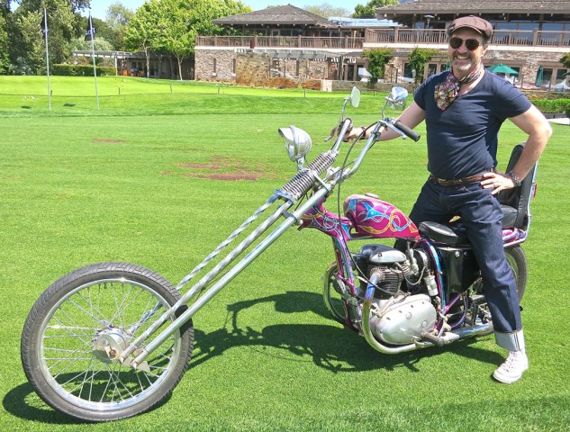 Master of Ceremonies, fashion maven and chopper book writer Paul d'Orleans honors the memory of Hunter Thompson on a BSA.