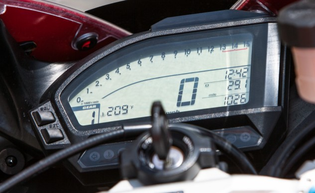 The gear-position indicator at the bottom left is a nod to modern convention, but otherwise the digital instrument cluster is devoid of all the information cluttering the readouts of R1s, RSVs, Panigale's and the like.