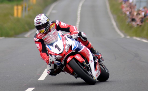 John McGuinness set a new record, averaging a speed of 132.701-mph over the 37 ¾-mile Mountain Course.