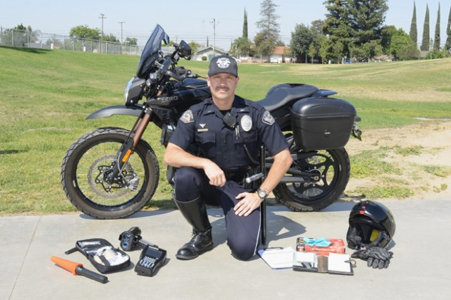 "Lieutenant Chris Perry displays all of the equipment carried on the department's Zeros. They include an electric flare, a first-aid kit, a Lidar speed gun, an electronic ticket ""book,"" disposable gloves and two clipboards for note-taking. The only extra piece of hardware carried on the V-Twins is a folding HK .223-caliber rifle."
