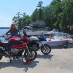 Lake Rosseau, up there in Ontario, Canada, isn't such a bad place after all, once the rain stops, the lake thaws and the mosquitoes retreat. This one's the accessorized-out model complete with Akrapovic pipe, hard bags and Big Hair.