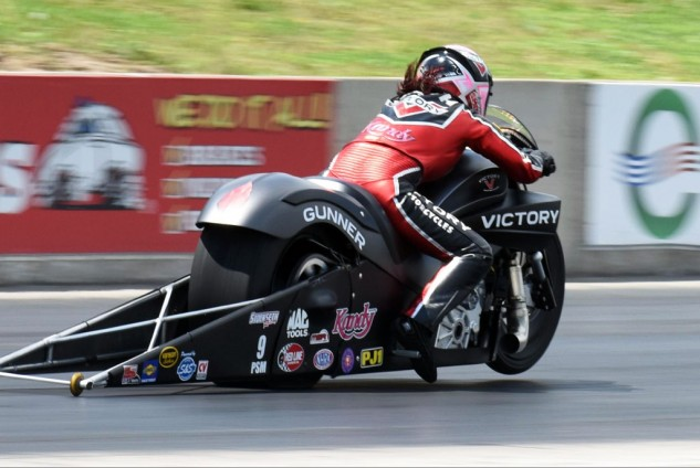 """If you've never seen an NHRA Pro Stock motorcycle launch down a dragstrip, you're missing a truly awesome sight. Matt and Angie Smith beat the """"American muscle"""" drum for Victory 1320 feet at a time."""