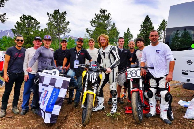 Clark, Nozaki-Miller, Nathan Barker and the entire Hollywood Electrics Racing team enjoying the fruits of their labor after a successful climb up Pikes Peak. Photo: Hollywood Electrics