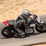 """Ergonomically, Clark's SR resembles more of a traditional sportbike, with its low bars and high pegs. Note the storage compartment in the center of the faux """"fuel tank."""" Contained within is the storage container for the coolant."""