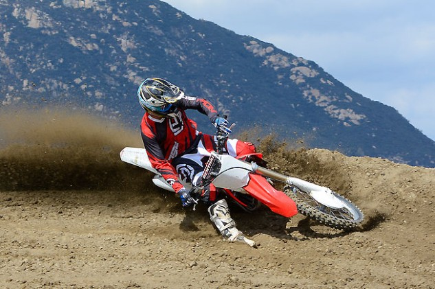 "Previous CRF450R models tended to oversteer in corners, causing the front end to ""knife"" or grab traction earlier than the rider wanted. The new fork and revised linkage make the steering more neutral, helping to increase rider confidence."