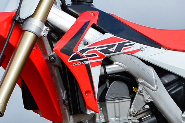 We're not fans of the CRF's angular radiator shrouds, which tend to snag knee guards and boot tops during hard cornering. The shrouds spoil an otherwise very good overall ergonomic package.